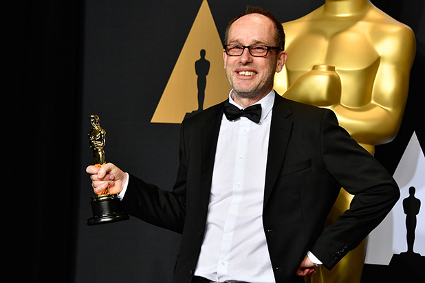 Editor John Gilbert, winner of Best Film Editing for 'Hacksaw Ridge' poses in the press room during the 89th Annual Academy Awards